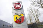 Logos of car companies are seen on the facade of the building housing the Stellantis headquarters in Lijnden, near Amsterdam, Netherlands, Monday, Jan. 18, 2021. Stellantis, the car company combining PSA Peugeot and Fiat Chrysler, was launched Monday on the Milan and Paris stock exchanges, giving life to the fourth-largest car company in the world. (AP Photo/Peter Dejong)