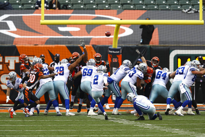 Dallas Cowboys kicker Greg Zuerlein (2) kicks a field goal against the Cincinnati Bengals in the second half of an NFL football game in Cincinnati, Sunday, Dec. 13, 2020. (AP Photo/Aaron Doster)