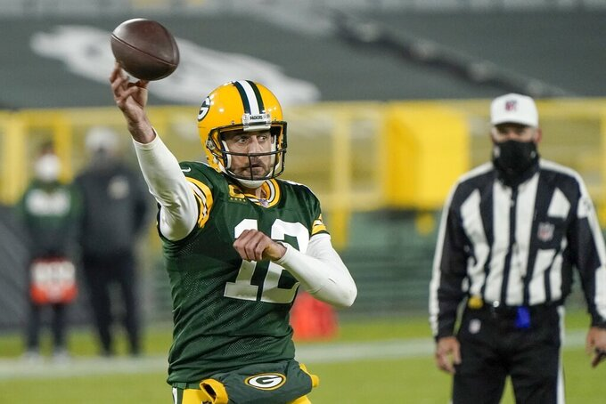 Green Bay Packers' Aaron Rodgers throws a touchdown pass during the second half of an NFL football game against the Philadelphia Eagles Sunday, Dec. 6, 2020, in Green Bay, Wis. The pass was Rodgers' 400th career touchdown pass. (AP Photo/Morry Gash)