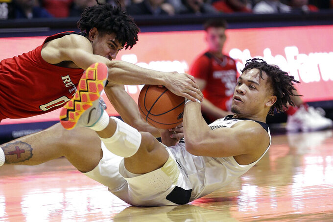 Purdue guard Carsen Edwards, right, wrestles for control of the ball with Rutgers guard Geo Baker during the second half of an NCAA college basketball game in West Lafayette, Ind., Tuesday, Jan. 15, 2019. Purdue won 89-54. (AP Photo/AJ Mast)