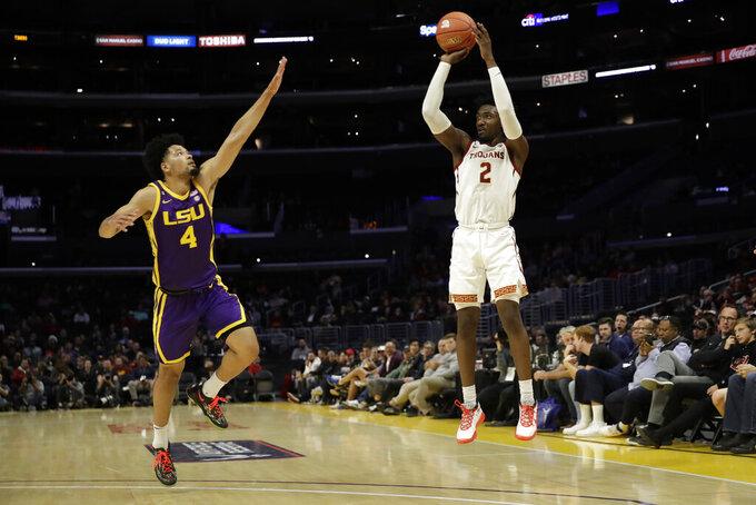 Southern California guard Jonah Mathews (2) shoots over LSU guard Skylar Mays (4) during the first half of an NCAA college basketball game Saturday, Dec. 21, 2019, in Los Angeles. (AP Photo/Marcio Jose Sanchez)