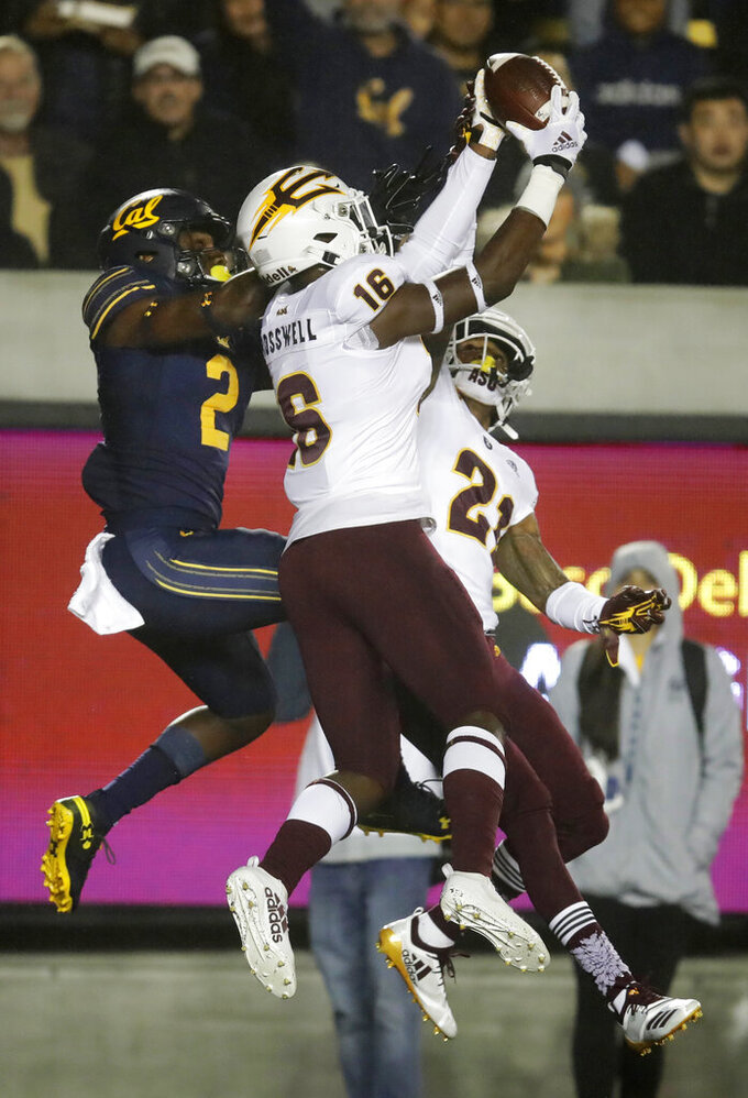 Arizona State's Aashari Crosswell (16) intercepts a pass intended for California's Jordan Duncan (2) during the first half of an NCAA college football game Friday, Sept. 27, 2019, in Berkeley, Calif. (AP Photo/Ben Margot)