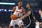 Brooklyn Nets forward Wilson Chandler (21) defends New York Knicks forward Bobby Portis (1) as Portis rives to the basket during the first half of an NBA basketball game in New York, Sunday, Jan. 26, 2020. (AP Photo/Kathy Willens)