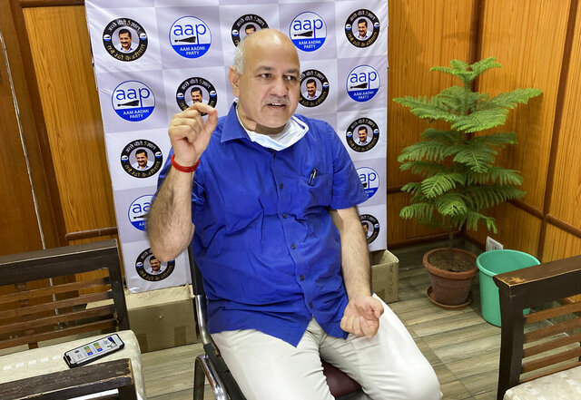 """Acting health minister of India's capital New Delhi Manish Sisodia speaks during an interview with The Associated Press in New Delhi, India, Saturday, June 27, 2020. Sisodia said Saturday that New Delhi is facing a shortage of """"trained and experienced"""" health care workers, providing a major challenge in a city that is the epicenter of the country's coronavirus outbreak. (AP Photo/Shonal Ganguly)"""
