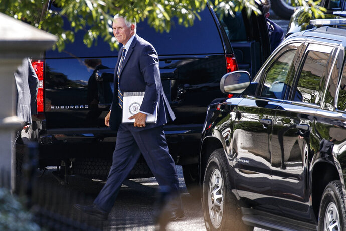 Vice President Mike Pence arrives to the West Wing of the White House, Sunday, Sept. 15, 2019, in Washington. (AP Photo/Jacquelyn Martin)