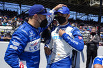 Tony Kanaan, left, of Brazil, greets Alex Palou, of Spain, before the Indianapolis 500 auto race at Indianapolis Motor Speedway in Indianapolis, Sunday, May 30, 2021. (AP Photo/Michael Conroy)