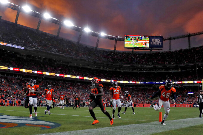 Cleveland Browns wide receiver Jarvis Landry (80) scores a touchdown as Denver Broncos linebacker A.J. Johnson (45), defensive back Duke Dawson (20), and linebacker Justin Hollins (52) defend during the second half of NFL football game, Sunday, Nov. 3, 2019, in Denver. (AP Photo/David Zalubowski)