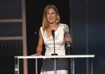 Jennifer Aniston accepts the award for outstanding performance by a female actor in a drama series for