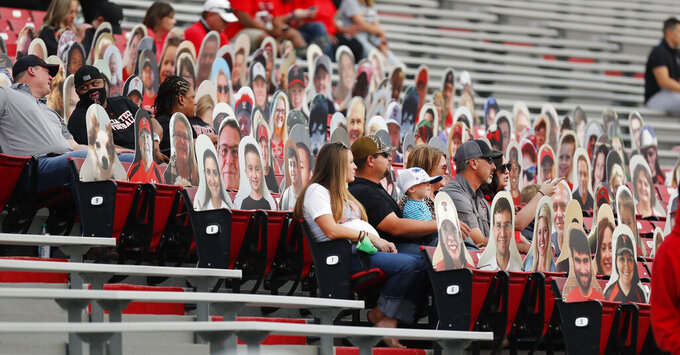 Texas Tech fans sit among the ImpersonRaiders designed to make the stands look more full before an NCAA college football game against Houston Baptist, Saturday, Sept. 12, 2020, in Lubbock, Texas. (AP Photo/Mark Rogers)