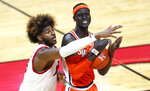 Rutgers center Myles Johnson, left, defends against Syracuse center John Bol Ajak during the first half of an NCAA college basketball game in Piscataway, N.J., Tuesday, Dec. 8, 2020. (AP Photo/Noah K. Murray)