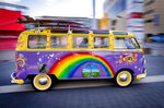 File---Picture taken Sept.10, 2019 shows a painted Volkswagen T1 old-timer cruising over the fairground at the IAA Auto Show in Frankfurt, Germany. The T1 was built from 1950 to 1967. (AP Photo/Michael Probst)