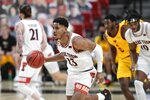 Texas Tech's Chibuzo Agbo (23) brings the ball up during the second half of the team's NCAA college basketball game against Iowa State in Lubbock, Texas, Thursday, March 4, 2021. (AP Photo/Justin Rex)