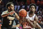 Illinois' Andres Feliz (10) goes in for a basket as Purdue's Jahaad Proctor (3) defends in the first half of an NCAA college basketball game, Sunday, Jan. 5, 2020, in Champaign, Ill. (AP Photo/Holly Hart)