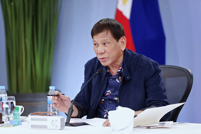 In this handout photo provided by the Malacanang Presidential Photographers Division, Philippine President Rodrigo Duterte talks during a meeting with the Inter-Agency Task Force on the Emerging Infectious Diseases at the Malacanang Presidential Palace in Manila, Philippines on Tuesday Aug. 24, 2021. The Philippines' tough-talking President has confirmed rumblings that he will run next year for vice president, in what critics say is an attempt at an end-run around constitutional term limits. (Karl Alonzo/Malacanang Presidential Photographers Division via AP)