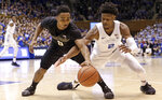 Duke's Cam Reddish (2) and Wake Forest's Brandon Childress (0) reach for the ball during the second half of an NCAA college basketball game in Durham, N.C., Tuesday, March 5, 2019. Duke won 71-70. (AP Photo/Gerry Broome)