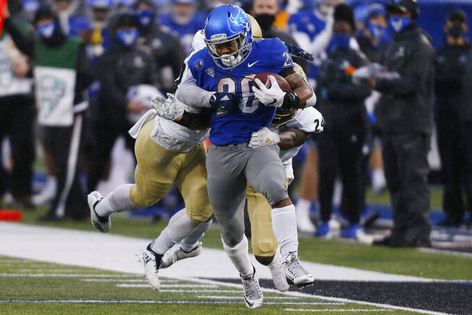 Buffalo running back Jaret Patterson (26) carries the ball during the first half of an NCAA college football game against Akron in Amherst, N.Y., Saturday, Dec. 12, 2020. (AP Photo/Jeffrey T. Barnes)