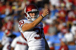 FILE - In this Saturday, Sept. 14, 2019 file photo, Oklahoma place kicker Calum Sutherland lines up a kick during the first half of an NCAA college football game against UCLA in Pasadena, Calif. Early Saturday, Sept. 21, 2019, Sutherland was arrested on a public intoxication charge, according to records from the Cleveland County Sheriff's Office in Norman, Okla. (AP Photo/Mark J. Terrill)