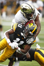 Purdue wide receiver David Bell, top, is tackled by Iowa defensive back Michael Ojemudia (11) after catching a pass during the second half of an NCAA college football game, Saturday, Oct. 19, 2019, in Iowa City, Iowa. Iowa won 26-20. (AP Photo/Charlie Neibergall)