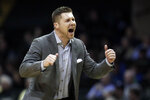 UNC Asheville coach Mike Morrell yells to his team in the second half of an NCAA college basketball game against Vanderbilt, Monday, Dec. 31, 2018, in Nashville, Tenn. (AP Photo/Mark Humphrey)