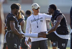 Wake Forest head football coach Dave Clawson talks with wide receivers Jaquarii Roberson (82) and Kendall Hinton, left, during the first day of NCAA college football practice in Winston-Salem, N.C., Thursday, Aug. 1, 2019. (Walt Unks/Winston-Salem Journal via AP)