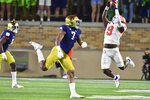 Clemson running back Travis Etienne (9) catches a pass as Notre Dame's Isaiah Foskey (7) defends during the third quarter of an NCAA college football game Saturday, Nov. 7, 2020, in South Bend, Ind. (Matt Cashore/Pool Photo via AP)