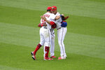 Washington Nationals left fielder Kyle Schwarber (12), Juan Soto, right, and Victor Robles, back center obscured, celebrate after a baseball game against the San Francisco Giants, Sunday, June 13, 2021, in Washington. The Nationals won 5-0. (AP Photo/Nick Wass)