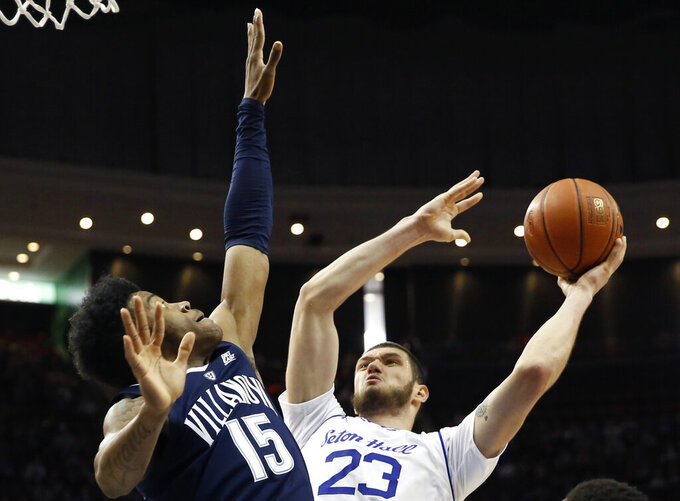 FILE - In this March 9, 2019, file photo, Villanova forward Saddiq Bey (15) defends Seton Hall forward Sandro Mamukelashvili (23) who goes up for a layup during the second half of an NCAA college basketball game in Newark, N.J. Mamukelashvili, at 6-11, is expected to move from the starting center spot for his more natural position at power forward.  (AP Photo/Kathy Willens, File)