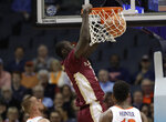 Florida State's Christ Koumadje (21) dunks against Virginia during the first half of an NCAA college basketball game in the Atlantic Coast Conference tournament in Charlotte, N.C., Friday, March 15, 2019. (AP Photo/Chuck Burton)