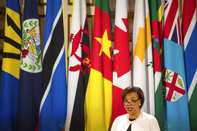 FILE - In this Thursday April 19, 2018 file photo, Commonwealth Secretary-General Patricia Scotland speaks during the formal opening of the Commonwealth Heads of Government Meeting in the ballroom at Buckingham Palace in London. Britain's Foreign Office said Wednesday Feb. 12, 2020, it has suspended its funding of the body that runs the Commonwealth over allegations of cronyism at the 54-nation international group. (Dominic Lipinski/Pool via AP, File)