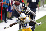 New Orleans Saints running back Alvin Kamara (41) pulls in a pass over Los Angeles Chargers strong safety Rayshawn Jenkins (23), setting up a touchdown, in the second half of an NFL football game in New Orleans, Monday, Oct. 12, 2020. The Saints won in overtime, 30-27. (AP Photo/Butch Dill)
