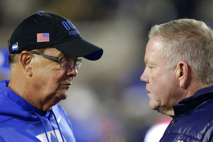Duke head coach David Cutcliffe, left, and Notre Dame head coach Brian Kelly speak prior to an NCAA college football game in Durham, N.C., Saturday, Nov. 9, 2019. (AP Photo/Gerry Broome)