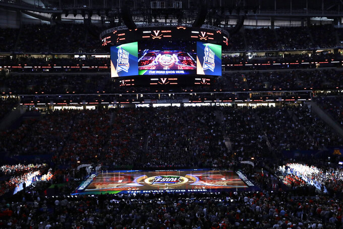 Fans cheer before a semifinal round game between Auburn and Virginia in the Final Four NCAA college basketball tournament, Saturday, April 6, 2019, in Minneapolis. (AP Photo/Matt York)