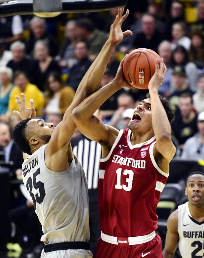 Stanford's Oscar Da Silva goes to the basket as Colorado's Dallas Walton defends during the first half of an NCAA college basketball game Saturday, Feb. 8, 2020, in Boulder, Colo. (AP Photo/Cliff Grassmick)