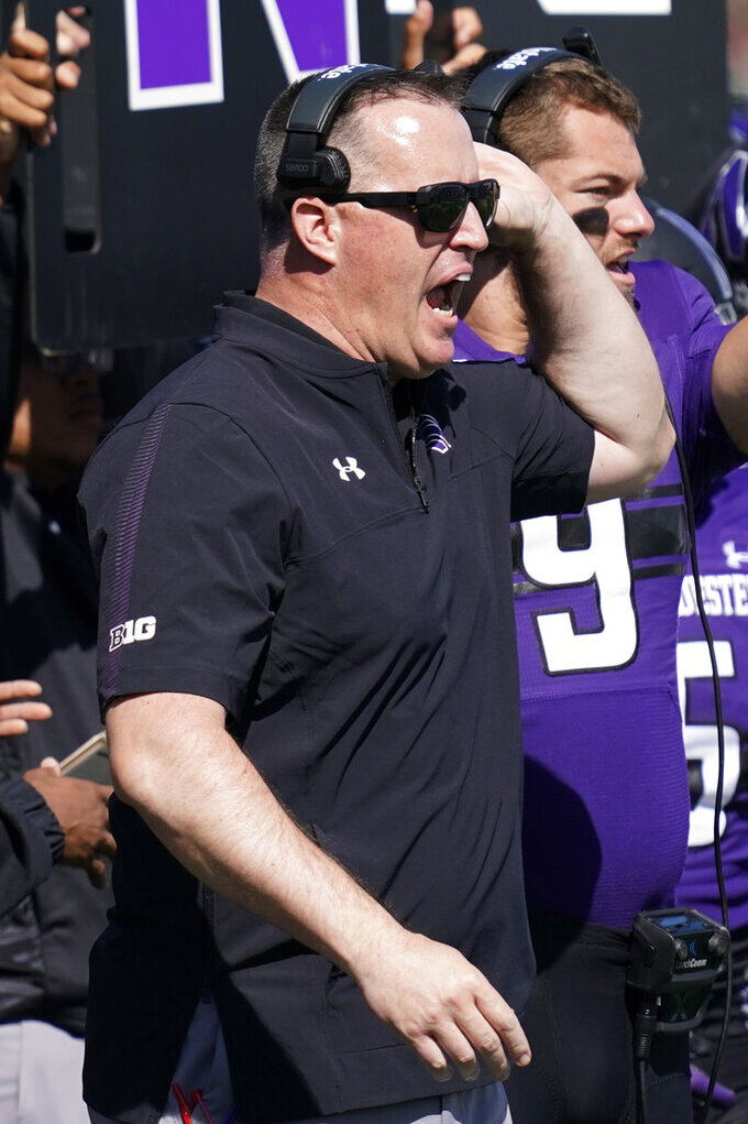 Northwestern head coach Pat Fitzgerald shouts out to his team during the first half of an NCAA college football game against Ohio in Evanston, Ill., Saturday, Sept. 25, 2021. (AP Photo/Nam Y. Huh)