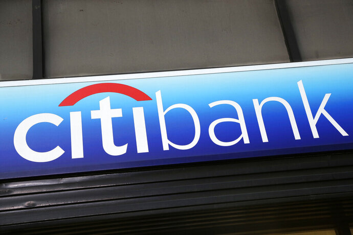 FILE - In this Jan. 15, 2015, file photo, a Citibank sign hangs above a branch office in New York.  The tens of millions of consumers and businesses out of work from the coronavirus pandemic weighed heavily on the financial results of Wall Street's biggest banks on Tuesday, July 14, 2020, with the likes of JPMorgan Chase, Wells Fargo and Citigroup setting aside tens of billions of dollars to cover potentially bad loans that were just fine only a few months ago. (AP Photo/Mark Lennihan, File)