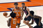 Illinois guard Jacob Grandison (3) hands the ball of to guard Ayo Dosunmu (11) as Penn State forward Trent Buttrick (15) and guard Myles Dread (2) defend during the first half of an NCAA college basketball game Tuesday, Jan. 19, 2021, in Champaign, Ill. (AP Photo/Holly Hart)