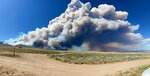 In this photo provided by the U.S. Forest Service, the Robertson Draw fire burns south of Red Lodge, Mont., Tuesday, June 15, 2021. The fire grew rapidly Tuesday amid a heat wave and gusting winds. (Amy Hyfield/U.S. Forest Service via AP)