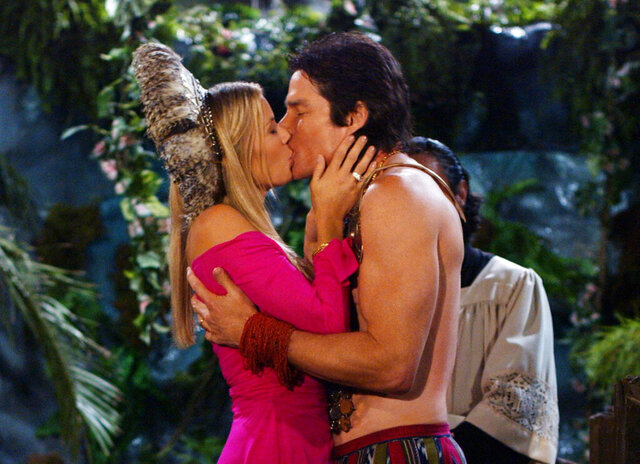 This 1994 image released by CBS shows Katherine Kelly Lang, left, and Ronn Moss in a scene from the daytime series