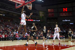 Nebraska guard Dachon Burke Jr. (11) makes a layup against Purdue during the first half of an NCAA college basketball game in Lincoln, Neb., Sunday, Dec. 15, 2019. (AP Photo/John Peterson)