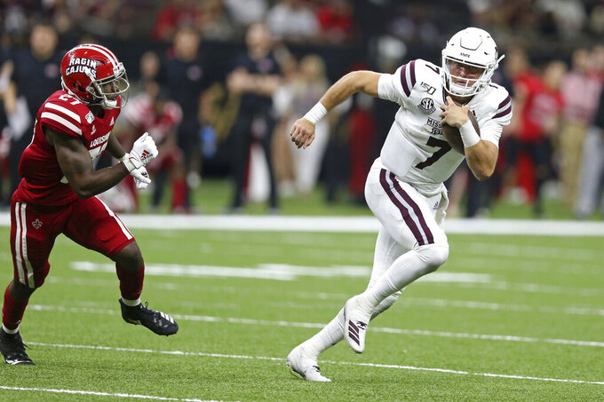 Mississippi State quarterback Tommy Stevens (7) is pursued by Louisiana-Lafayette defensive back Cameron Solomon (27) in the second half of an NCAA college football game in New Orleans, Saturday, Aug. 31, 2019. Mississippi State won, 38-28. (AP Photo/Chuck Cook)