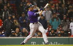 Colorado Rockies' Mark Reynolds watches his RBI single against the Boston Red Sox during the 11th inning of a baseball game Tuesday, May 14, 2019, at Fenway Park in Boston. (AP Photo/Winslow Townson)