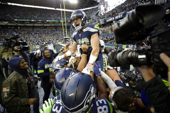 Seattle Seahawks tight end Jacob Hollister celebrates after he scored a touchdown against the Tampa Bay Buccaneers in overtime of an NFL football game, Sunday, Nov. 3, 2019, in Seattle.  (AP Photo/Scott Eklund)