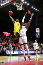 Maryland guard Serrel Smith Jr. (10) is fouled by Rutgers center Myles Johnson (15) while going up for shot during the first half of an NCAA college basketball game, Saturday, Jan. 5, 2019, in Piscataway, N.J. Maryland won 77-63. (AP Photo/Julio Cortez)