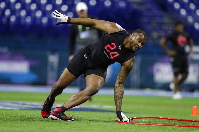 Alabama defensive lineman Raekwon Davis runs a drill at the NFL football scouting combine in Indianapolis, Saturday, Feb. 29, 2020. (AP Photo/Michael Conroy)