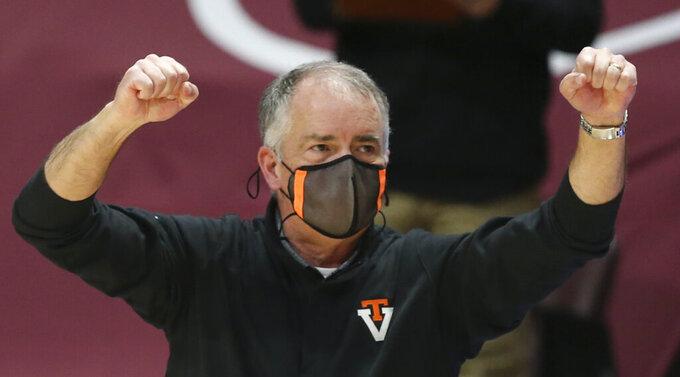 Virginia Tech head coach Mike Young celebrates a score against Virginia Tech in the first half of an NCAA basketball game in Blacksburg, Va., Saturday, Dec. 19 2020. (Matt Gentry/The Roanoke Times via AP, Pool)