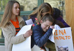 East chapel Hill students hug as they take part in a student walkout on Wednesday, March 14, 2018, in Chapel Hill, N.C.  Students across the country participated in walkouts Wednesday to protest gun violence, one month after a deadly shooting inside a high school in Parkland, Fla.   (Bernard Thomas/The Herald-Sun via AP)