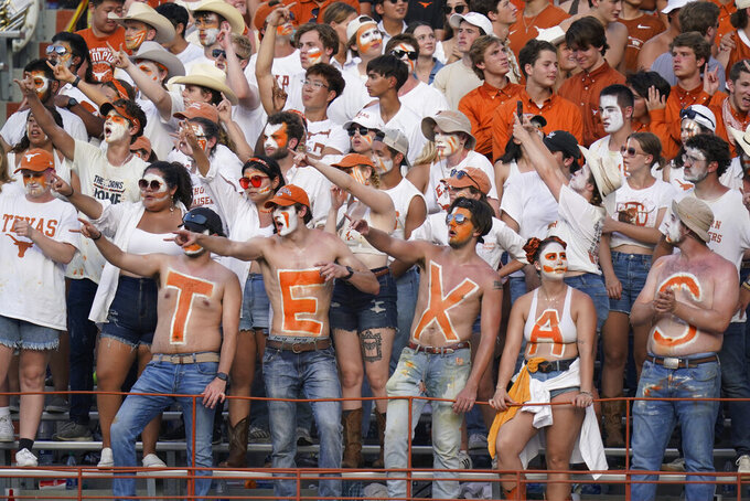 Texas fans celebrate during the second half of the team's NCAA college football game against Louisiana-Lafayette, Saturday, Sept. 4, 2021, in Austin, Texas. (AP Photo/Eric Gay)