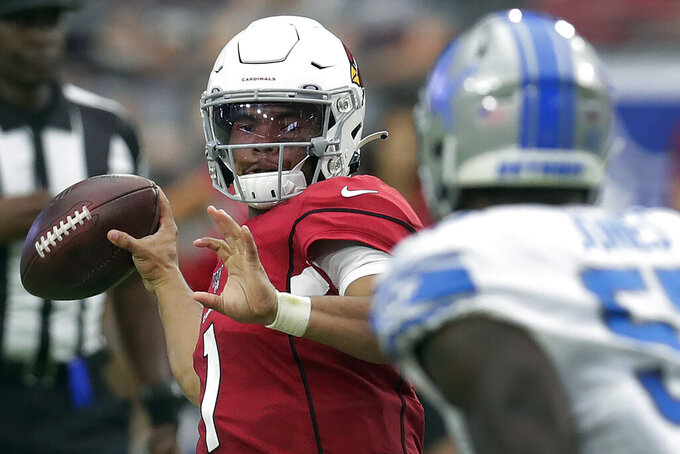 FILE - In this Sunday, Sept. 8, 2019, file photo, Arizona Cardinals quarterback Kyler Murray throws during the second half of an NFL football game as Detroit Lions outside linebacker Christian Jones looks on, in Glendale, Ariz. Lamar Jackson, Heisman Trophy owner (2016), meets Murray, who took that award last season on Sunday when the Baltimore Ravens host the Cardinals. AP Photo/Darryl Webb, File)