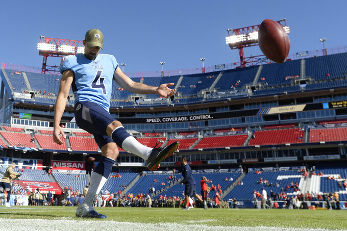FILE — In this Nov. 10, 2019, file photo, Tennessee Titans kicker Ryan Succop warms up before an NFL football game against the Kansas City Chiefs in Nashville, Tenn. The Titans have waived three-time Pro Bowl tight end Delanie Walker and kicker Ryan Succop. Injuries ended each of Walker's last two seasons.  Succop made only one field goal last season. The Titans announced the moves Friday, March 13, 2020 a day after waiving linebacker Cameron Wake and Dion Lewis. (AP Photo/Mark Zaleski, File)