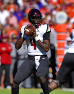 Louisville quarterback Jawon Pass drops back to pass during the first half of an NCAA college football game against Clemson Saturday, Nov. 3, 2018, in Clemson, S.C. (AP Photo/Richard Shiro)